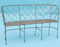 Bench with swirly detail on back and slatted seat base